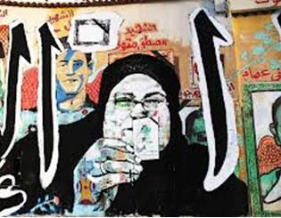 28. Madre di un martire che tiene in mano una fototessera del figlio scomparso
