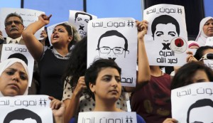 Protesters rally in support of Al Jazeera journalists Abdullah al-Shami and Mohammed Sultan, who were detained by Egyptian authorities, in front of the Press Syndicate in Cairo